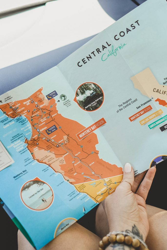 A woman's hand holding a colorful map of Central California.