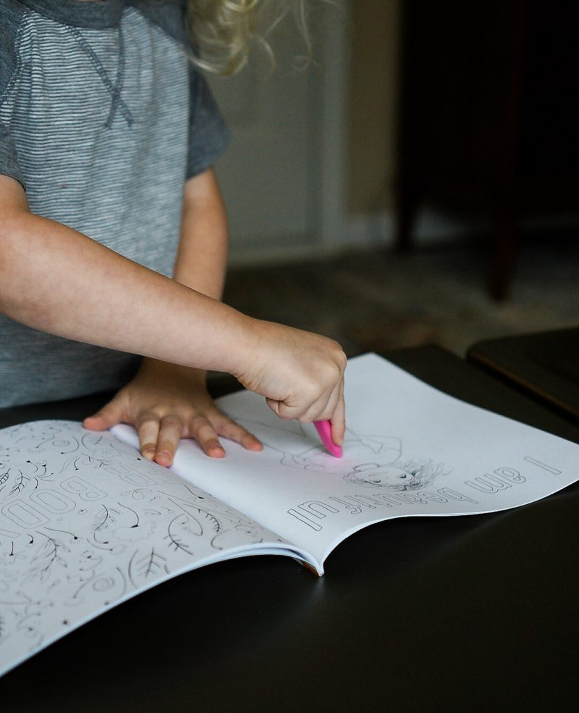 Katie Crenshaw's son colors the I am Beautiful page from Her Body Can (the coloring book).